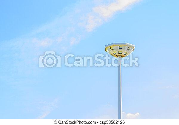 Light pole in the blue sky - csp53582126