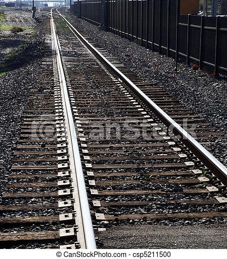 Light rail tracks city light rail tracks disappearing into distance light rail tracks csp5211500 mozeypictures Choice Image