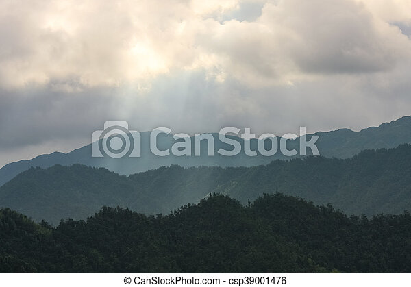 Light rays over mountain landscape - csp39001476