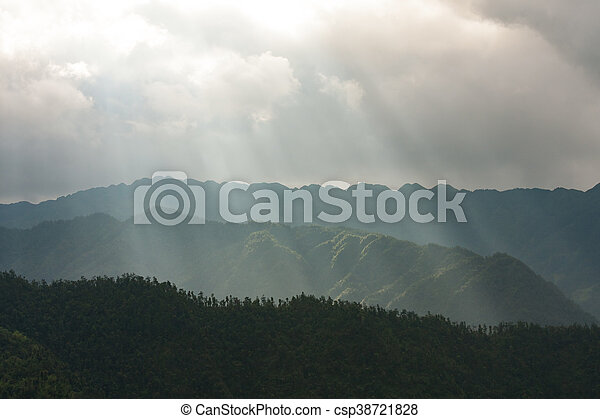 Light rays over mountain landscape - csp38721828