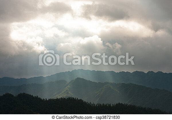 Light rays over mountain landscape - csp38721830