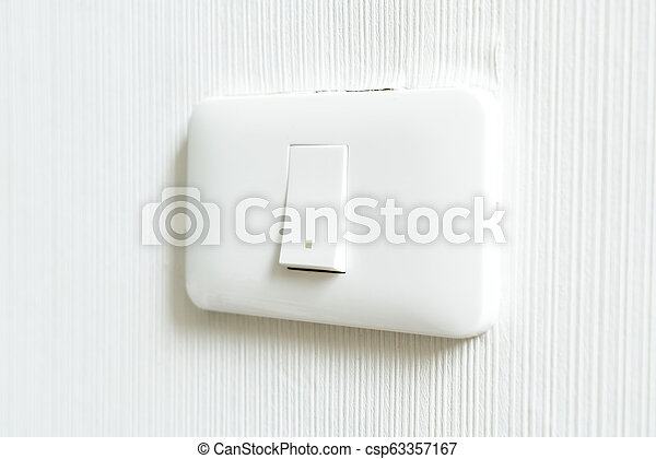 light switch on wall - csp63357167