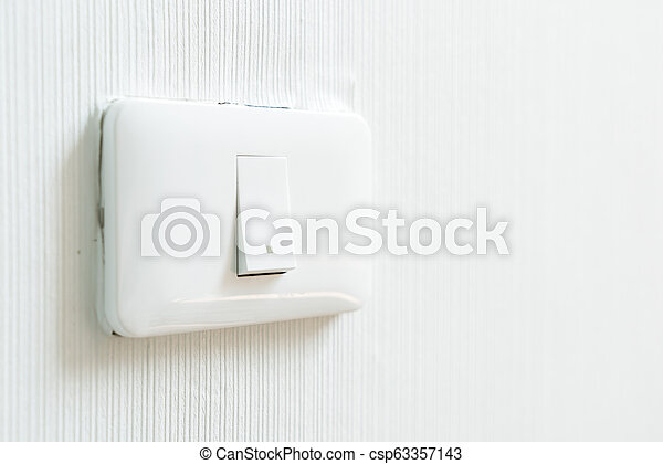 light switch on wall - csp63357143