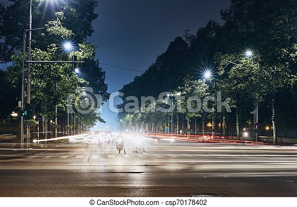 Light trails of traffic in city - csp70178402