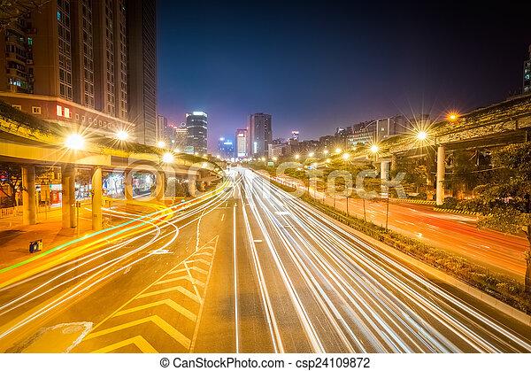 light trails on city road at night - csp24109872