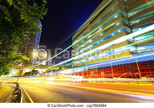 light trails on modern city at night - csp7664684