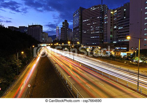light trails on modern city at night - csp7664690