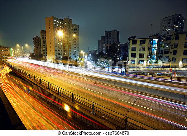 light trails on modern city at night - csp7664870