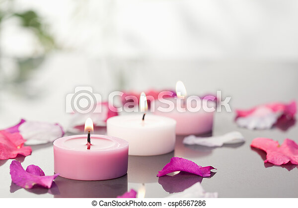 Lighted candles and petals - csp6567286