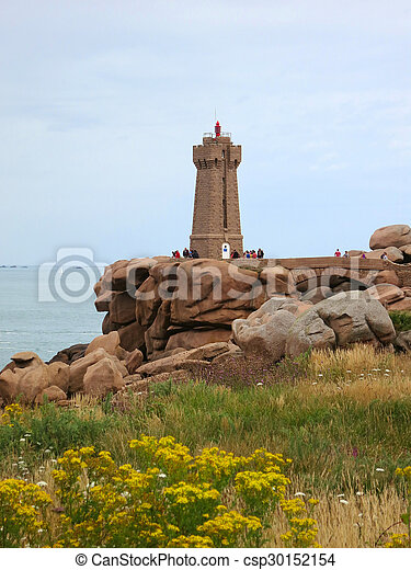 Lighthouse at cote de granite rose, brittany, france.... stock ...