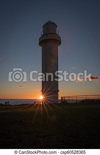 Lighthouse at dawn - csp60528365