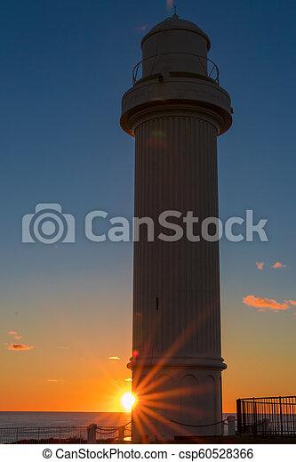 Lighthouse at dawn - csp60528366