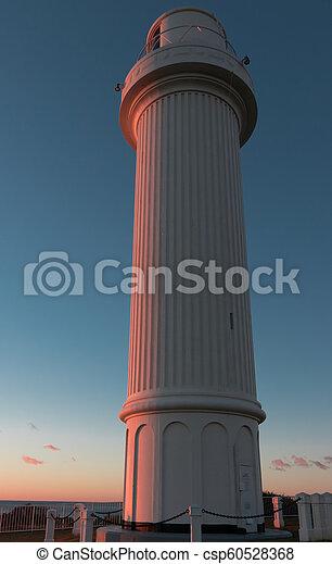 Lighthouse at dawn - csp60528368