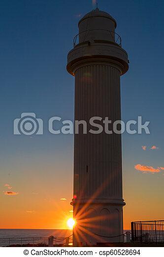 Lighthouse at dawn - csp60528694