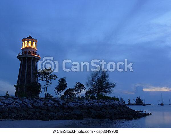lighthouse at dusk - csp3049900