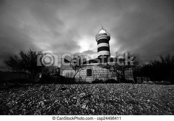 Lighthouse at night - csp24498411