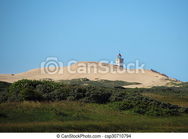 Lighthouse at Rubjerg Knude with Sand dune and Blue Sky - csp30710794