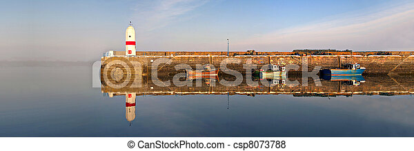 Lighthouse, Harbour, Boats with Sea and Water Reflection - csp8073788