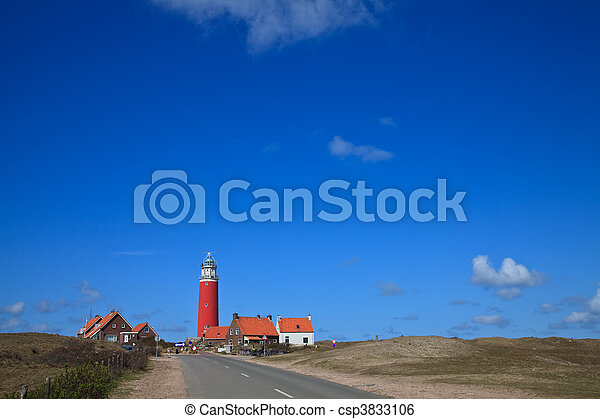 Lighthouse in the dunes at the beach - csp3833106