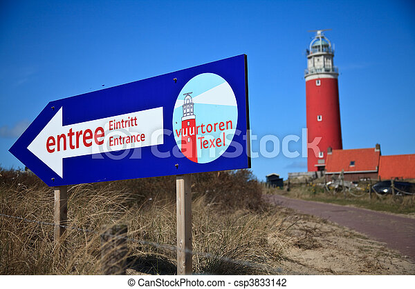 Lighthouse in the dunes at the beach - csp3833142