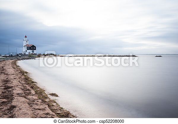 lighthouse on a cloudy day - csp52208000