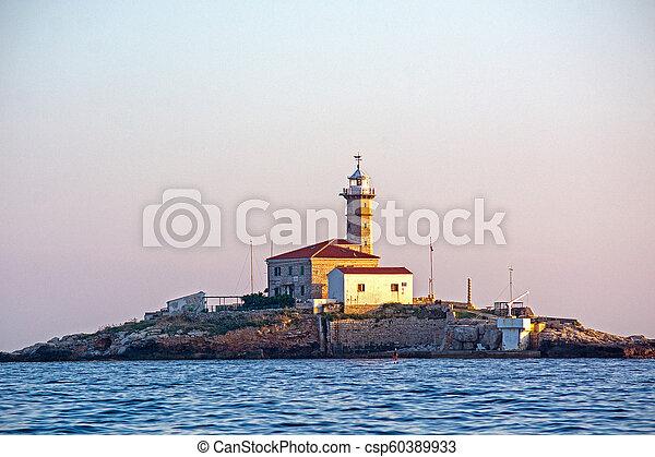 Lighthouse on island in Croatia - csp60389933