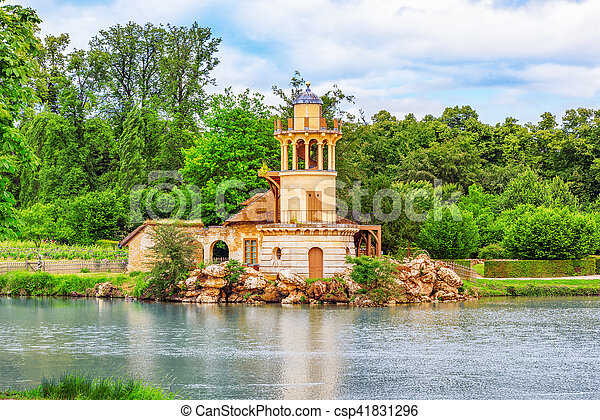Lighthouse on the lake in  hamlet Queen Marie Antoinette's estate near Versailles Palace. - csp41831296