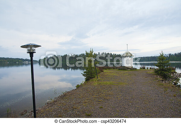 Lighthouse on the shore of lake - csp43206474