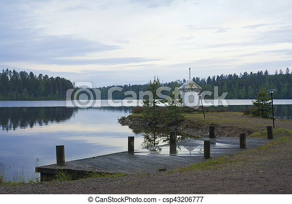 Lighthouse on the shore of lake - csp43206777