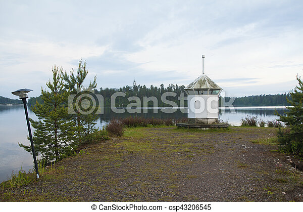 Lighthouse on the shore of lake - csp43206545