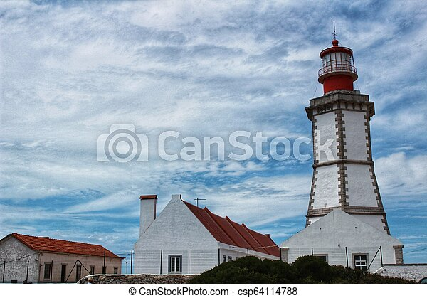 Lighthouse on top of cliff and surrounded by vegetation at Cape Espichel - csp64114788