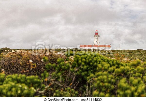 Lighthouse on top of cliff and surrounded by vegetation at Cape Espichel - csp64114832