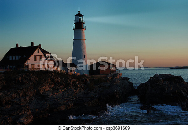 lighthouse shining at dawn - csp3691609
