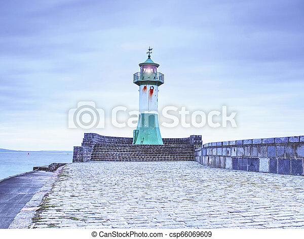 Lighthouse tower on stony mole in Sasssnitz - csp66069609