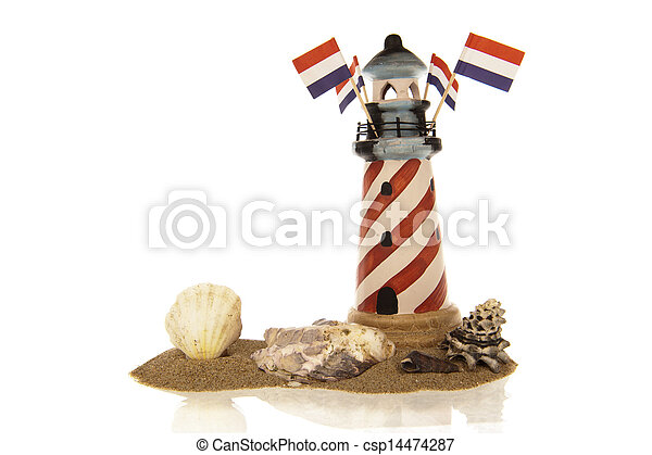 Lighthouse with flags and shells in sand - csp14474287