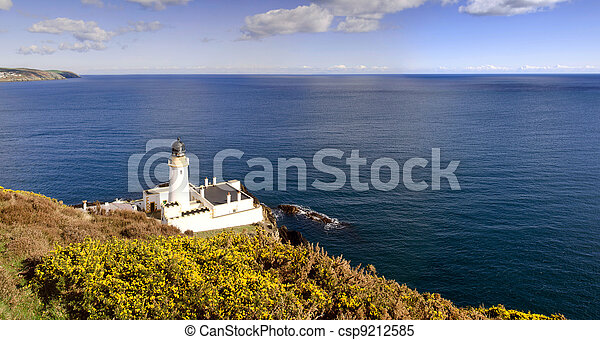 Lighthouse with Yelllow shrub and sea in background - csp9212585
