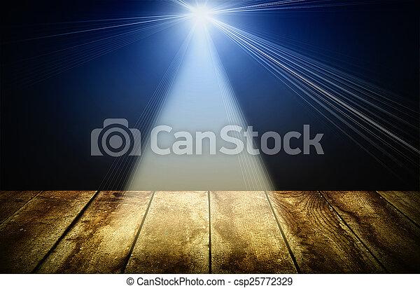 lighting over dark background and wood floor - csp25772329