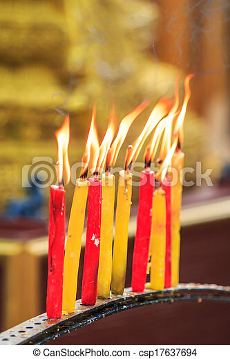 lighting prayer candle offering, sacrificial or memorial candle