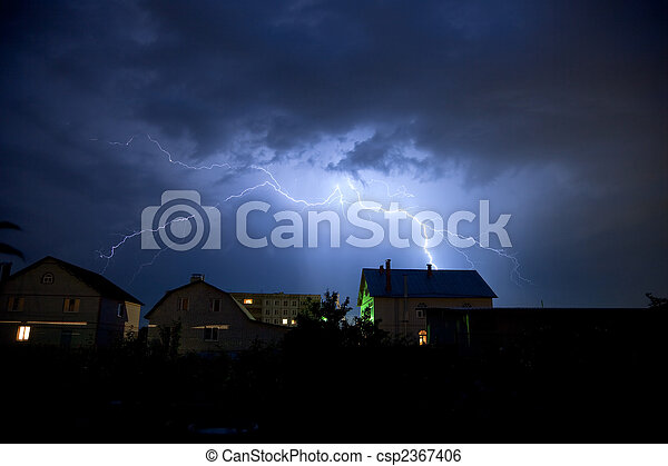 Lightning in the cloudy sky over village - csp2367406