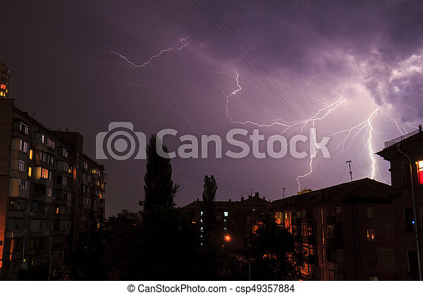 Lightning over the houses - csp49357884