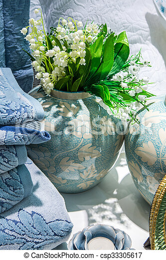 Lilies of the valley in vase - csp33305617