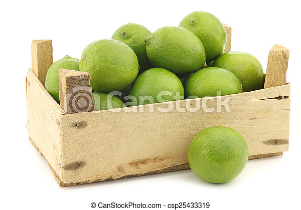 lime fruits in a wooden crate - csp25433319