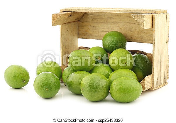 lime fruits in a wooden crate - csp25433320