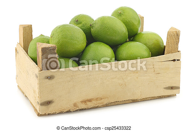 lime fruits in a wooden crate - csp25433322