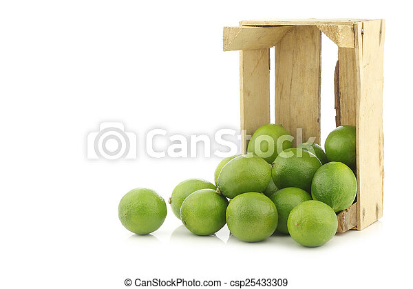 lime fruits in a wooden crate - csp25433309