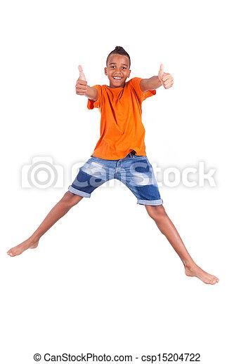 Retrato de un lindo adolescente negro saltando sobre un fondo blanco, gente africana - csp15204722