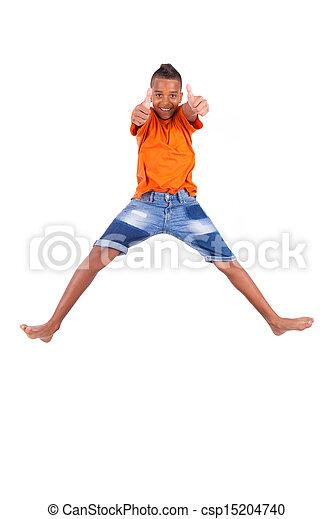 Retrato de un lindo adolescente negro saltando sobre un fondo blanco, gente africana - csp15204740