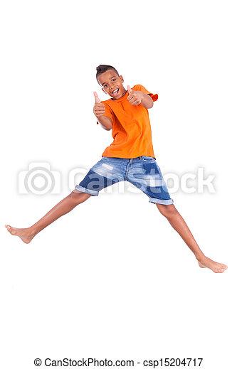 Retrato de un lindo adolescente negro saltando sobre un fondo blanco, gente africana - csp15204717