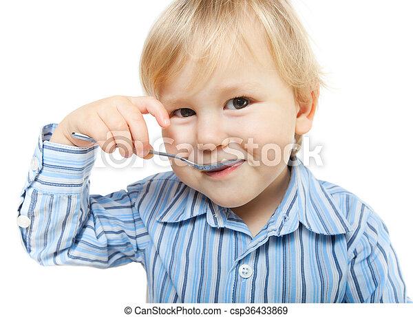 Un niño lindo comiendo - csp36433869