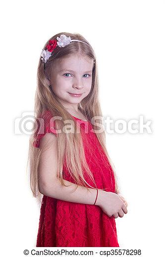 Linda chica sonriente con vestido rojo - csp35578298